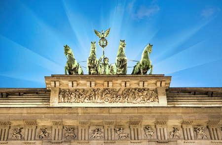 quadriga: Illuminated quadriga on top of Brandenburg Gate in Berlin, Germany