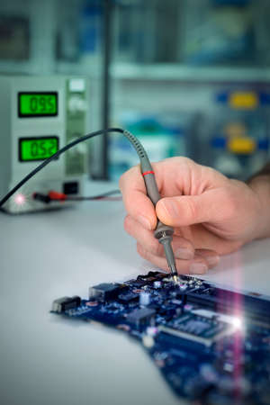 lab tech: Electronic background, closeup on hands of tech fixing motherboard. Toned image, vignette, extra light effects. Shallow DOF, focus on the tester tool, space for your text