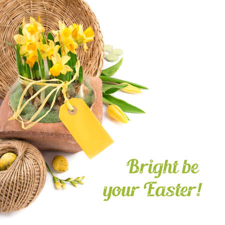 Easter border with yellow tulips, daffodils and natural decorations, space for your text photo