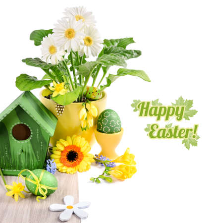 Easter border with spring flowers and handmade decorations on wooden table, isolated on white, space for your text photo