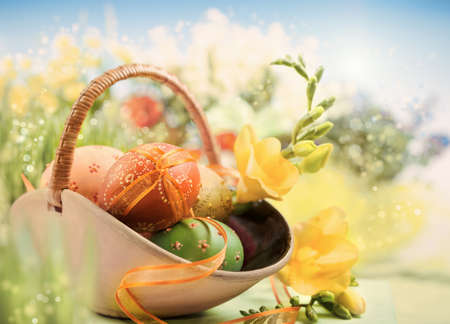 Easter background with eggs and spring flowers, shallow DOF, focus on the part of front egg with the ribbon. This image is toned.