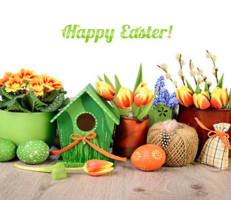 egg roll: Horizontal Easter border with flowers and decorations isolated on white. Space for your text both on white above and on wood below