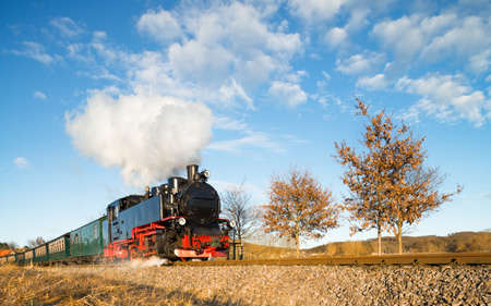 black train: Historical steam train on island Rugen in Germany Stock Photo