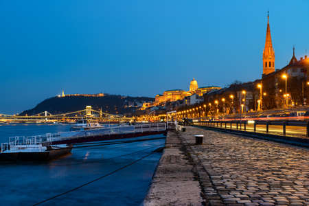 Danube waterfront in Pest with a view over Chain Bridge and Buda Castle at night photo