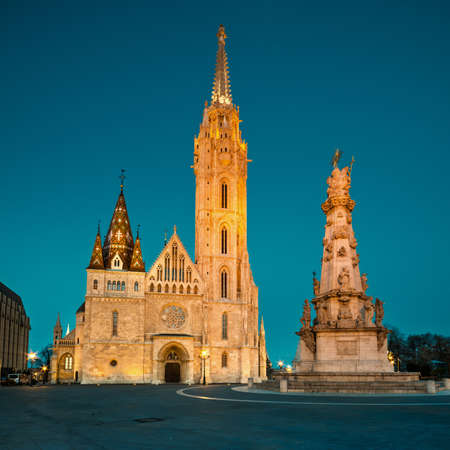 square image: Matthias church and Statue of Holy Trinity in Budapest, Hungary, early evening. Square composition. This image is toned.