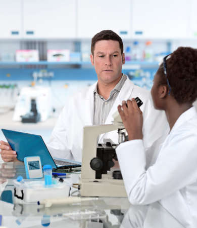 histological: Senior scientist and graduate student work in histological lab Stock Photo