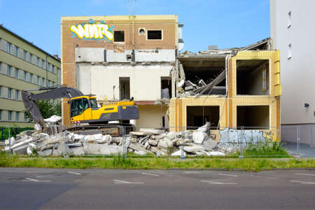 abandoned: Excavator alongside abandoned building ready for demolition in former East Berlin, Germany Stock Photo