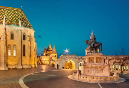 fisherman bastion: Fishermans Bastion in Budapest, Hungary in the evening. Focus on the horseman statue. This image is toned Editorial