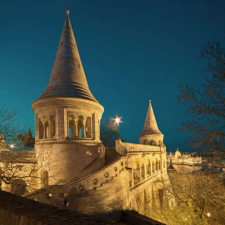 square image: Fishermans Bastion in Budapest, Hungary at night. Vertical panorama made from three frames. Square composition. This image is toned.