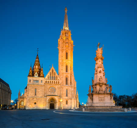 gothic church: Matthias church and Statue of Holy Trinity in Budapest, Hungary, early evening