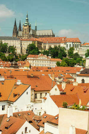 brigh: View on St. Vitus Cathedral and Prague Castle on a brigh Summer day in Prague. This image is toned for vintage look