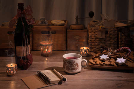 red kitchen: Christmas kitchen with mulled wine and cookies on the table