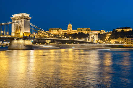 brige: Budapest Castle and famous Chain Bridge in Budapest at night. Focus on the brige.