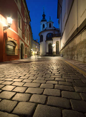 salvator: Old Prague at night, old street with historical houses and church of St. Salvator Stock Photo