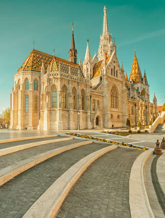 castle district: Matthias church in Buda Castle district, Budapest, Hungary on a bright day. This image is toned Editorial
