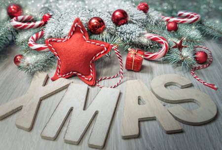 decoration: Wooden letters Xmas and winter decorations in red, beige and green. Merry Christmas!