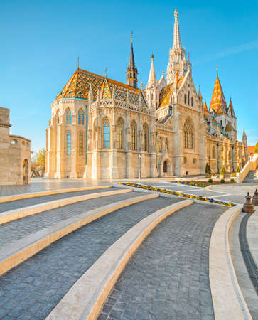 castle district: Matthias church in Buda Castle district, Budapest, Hungary on a bright day Editorial