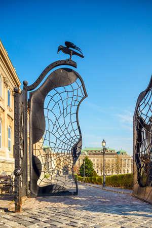 buda: Ornate iron gate with raven on Buda Castle grounds. Budapest, Hungary