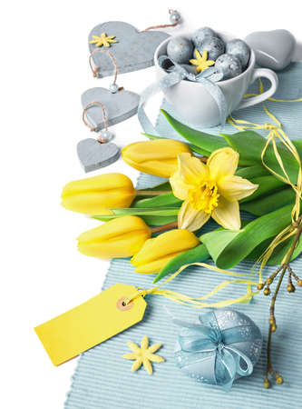 easter flowers: Easter border with yellow tulips and pale blue spring decorations, space for your text