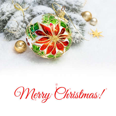 christmas baubles: Christmas greeting card. Christmas bauble with poinsettia design, decorated branches of Christmas tree on snow. Space for your text on plain white background below the picture. Stock Photo