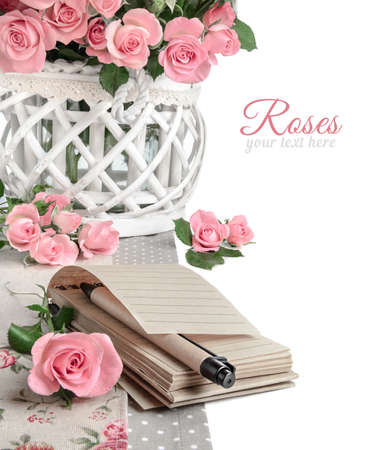 unwashed: Blank notebook among beautiful pink roses, isolated on white. Space for your note on the page, space for your text on the right. Design for cooking book or a greeting card, an Anniversary, Mothers day or St. Valentine. This image is toned. Stock Photo