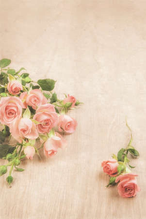 st  valentine       day: Small pink roses on wooden table, romantic background for your St Valentines design or a greeting card. This image is toned. Stock Photo