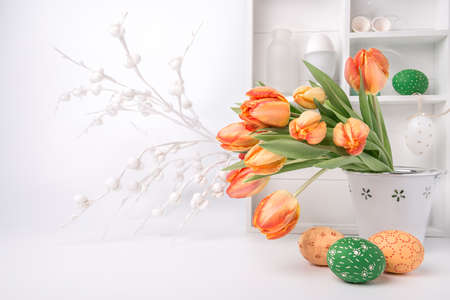 show case: Easter greeting card design with bunch of tulips and painted eggs on abstract white background
