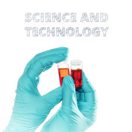 applied: Hands in turquoise gloves hold two red liquid samples. Element for your scientific or applied medical design, isolated on white.