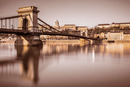 buda: Budapest Castle and famous Chain Bridge in Budapest early morning. Focus on the bridge. This image is toned.
