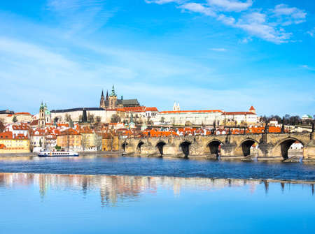 praha: Charles Bridge, St. Vitus Cathedral and other historical buildings in Prague, panorama from the opposite river bank Stock Photo