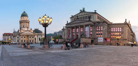 seventeenth: BERLIN, GERMANY - APRIL 30, 2016: Gendarmenmarkt square in Berlin early in the evening. The square was created by Johann Arnold Nering at the end of the seventeenth century. Editorial