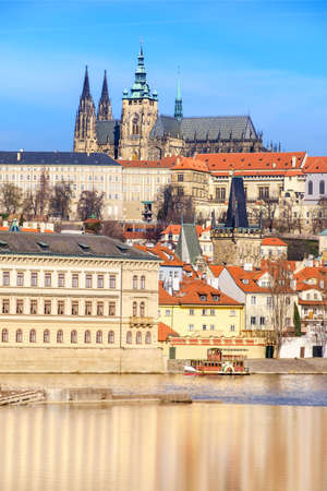 brigh: View on St. Vitus Cathedral and Prague Castle across Vltava river on a brigh Autumn day