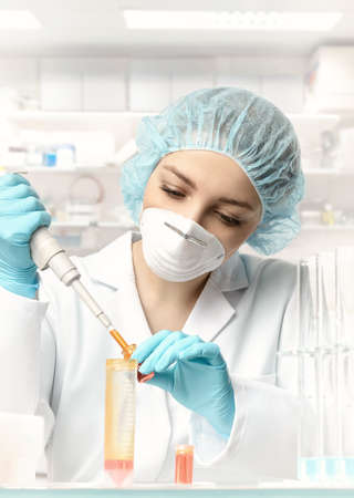 healthcare portrait: Young female tech or scientist loads sample with automatic pipette. This image is toned.