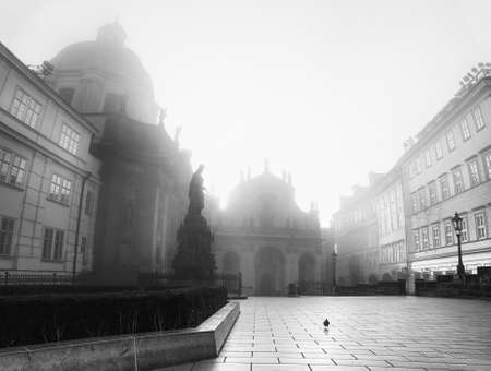 francis: Prague on a sunrise in black and white. Town square with Church of St. Francis of Assisi in morning mist Stock Photo