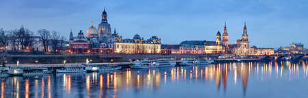 passenger ships: Night panorama of Dresden Old town with reflections in Elbe river and passenger ships in Saxony, Germany