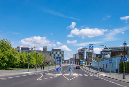 buisiness: BERLIN, GERMANY - APRIL 29, 2016: Panorama of a street with modern buildings in Central Berlin on a bright sunny day. Berlin is the capital of Germany and important buisiness center in Europe.