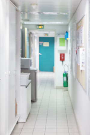 no image: Blurred scientific or medical background. Corridor in modern reseach facility with fridges and freezers out of focus. This image is blurred, there is no focal point here.