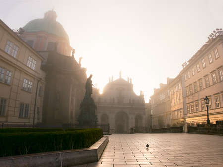 francis: Prague on a sunrise, town square with Church of St. Francis of Assisi in morning mist