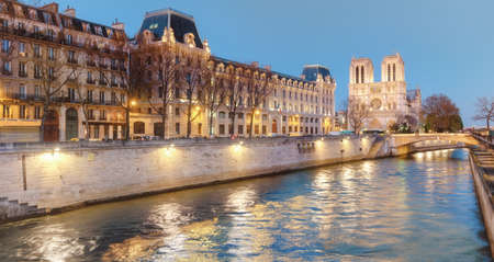 restaurant exterior: Eveing panorama of Paris with illuminated  Notre-Dame cathedral