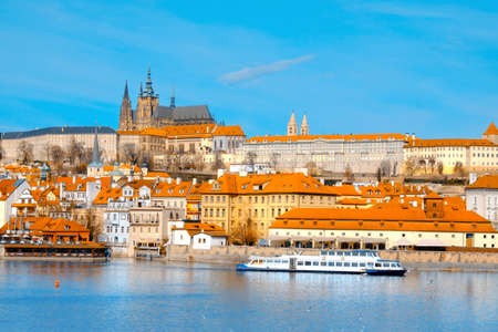 brigh: View on St. Vitus Cathedral and Prague Castle across Vltava river on a brigh Autumn day. This image is toned. Stock Photo