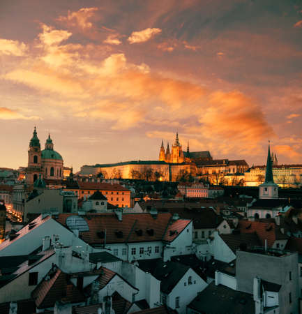 Roofs of Prague and St. Vitus Cathedral in the evening. This image is toned. Stock Photo