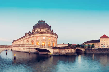 Night time illuminations of Museum Island in Berlin, Germany. Panorama image, that has been tinted.