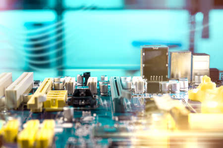 hardware repair: Closeup on electronic board in hardware repair shop, blurred and toned image. Shallow DOF, no focal point. Stock Photo