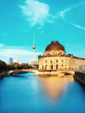 Museum island in Berlin on river Spree early afternoon. This image is toned. Space for your text. Editorial