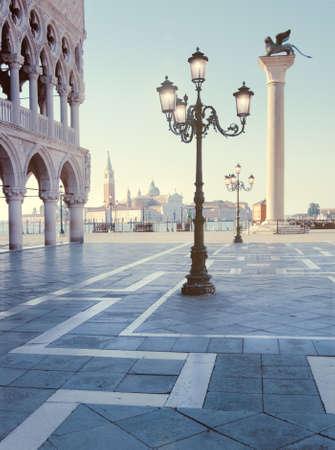 saint mark square: Saint Mark square with San Giorgio di Maggiore church in the background - Venice, Venezia, Italy, Europe. This image is toned. Stock Photo
