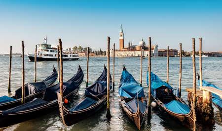 square image: Gondolas moored by Saint Mark square with San Giorgio di Maggiore church in the background. Venice, Venezia, Italy, Europe. This image is toned. Stock Photo