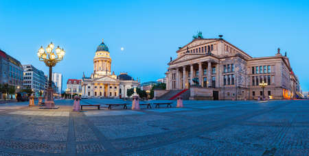 Panorama image of Gendarmenmarkt square in Berlin with German church and Concert Hall at dawn