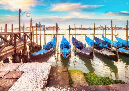 square image: Gondolas moored by Saint Mark square with San Giorgio di Maggiore church in the background. Venice, Venezia, Italy, Europe. This image is toned. Editorial