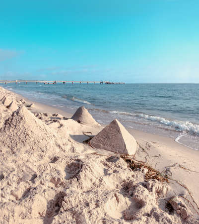 Sand castles in shape of pyramides on a beach on Baltic Sea in Northern Germany Stock Photo