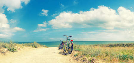 Bikes at the Beach of the Baltic Sea, panorama. This image is toned.
